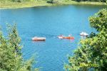 our three boats in the bay: rowboat, paddleboat, canoe