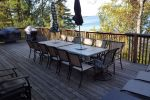 Stunning 40 foot wide deck, 2 bbqs, ample seating & lounges overlooking the lake
