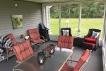 Screened In sunroom and entertainment area