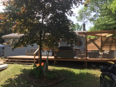 Well treed shady lot with large deck